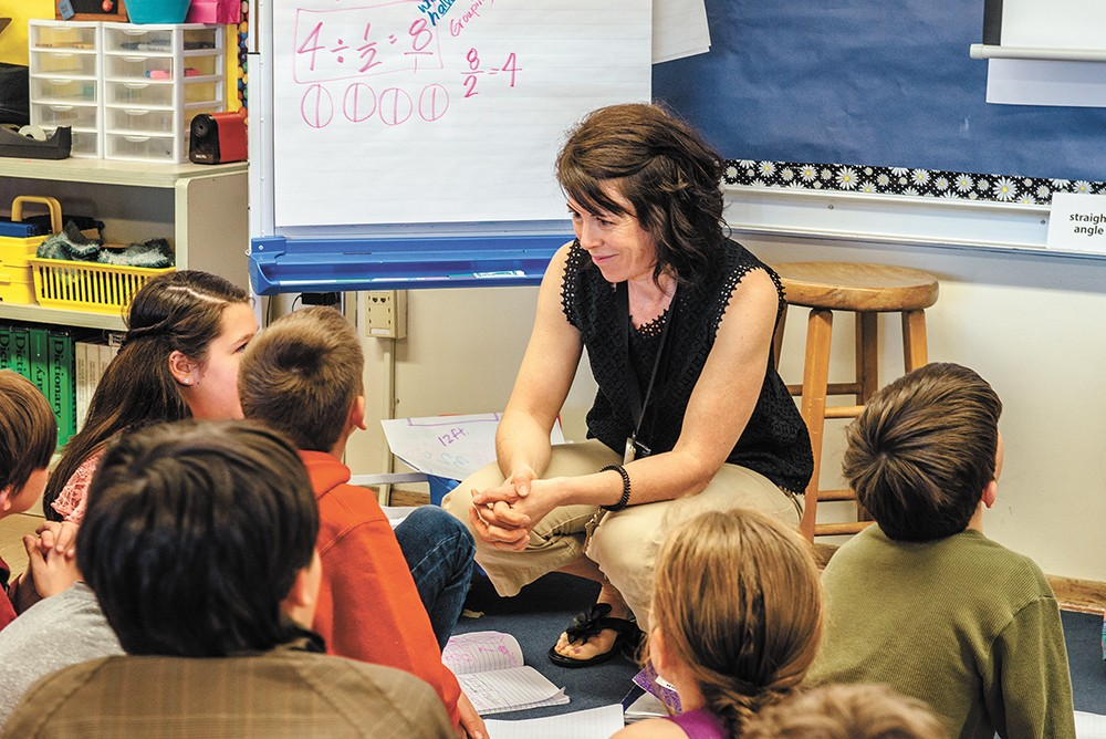 Fourth- and fifth-grade teacher Beth O'Regan tries to get her students to think like mathematicians. - ERICK DOXEY PHOTO