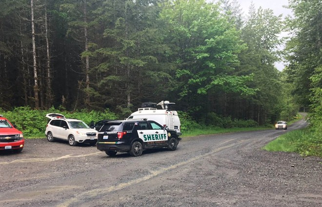The authorities responding near Lake Hancock, northeast of Snoqualmie, Wash., where a cougar attacked two bicyclists on Saturday, killing one of them. - SGT. RYAN ABBOTT/KING COUNTY SHERIFF'S OFFICE