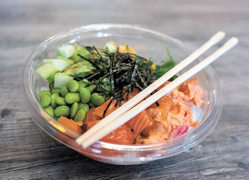 The salmon poke bowl with a side of spicy tuna. - HECTOR AIZON PHOTO