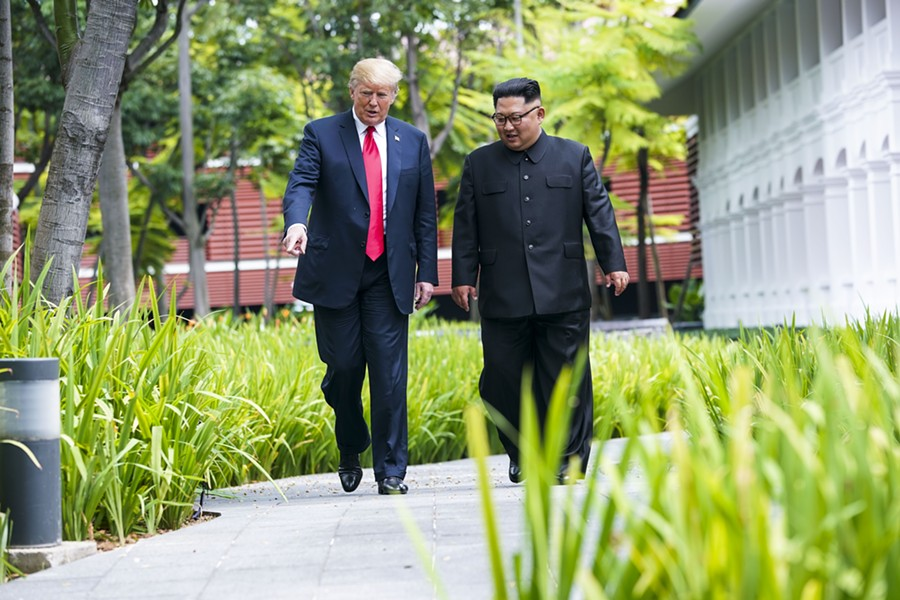 President Donald Trump gestures to Kim Jong Un of North Korea as they take a walk after their lunch on Sentosa Island in Singapore, June 12, 2018. Trump's eager embrace of Kim this week, on the heels of an acrid falling-out with Prime Minister Justin Trudeau of Canada, raised an obvious, if confounding, question: Why would an American president offend allies and cozy up to adversaries? - DOUG MILLS/THE NEW YORK TIMES