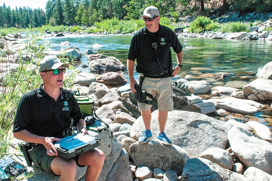 Spokane County Sheriff deputies Brad Humphrey and Jim Ebel conduct life-jacket emphasis patrols on the river last month. - DANIEL WALTERS PHOTO