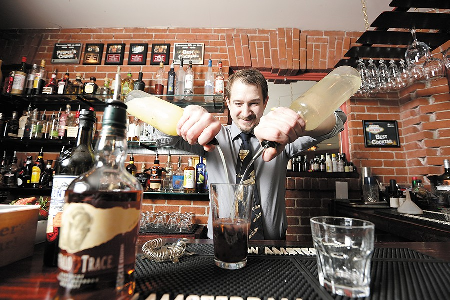 Bar Manager Ryan Roberge mixes up a Minnesota Bramble at 315 Martini & Tapas. - YOUNG KWAK