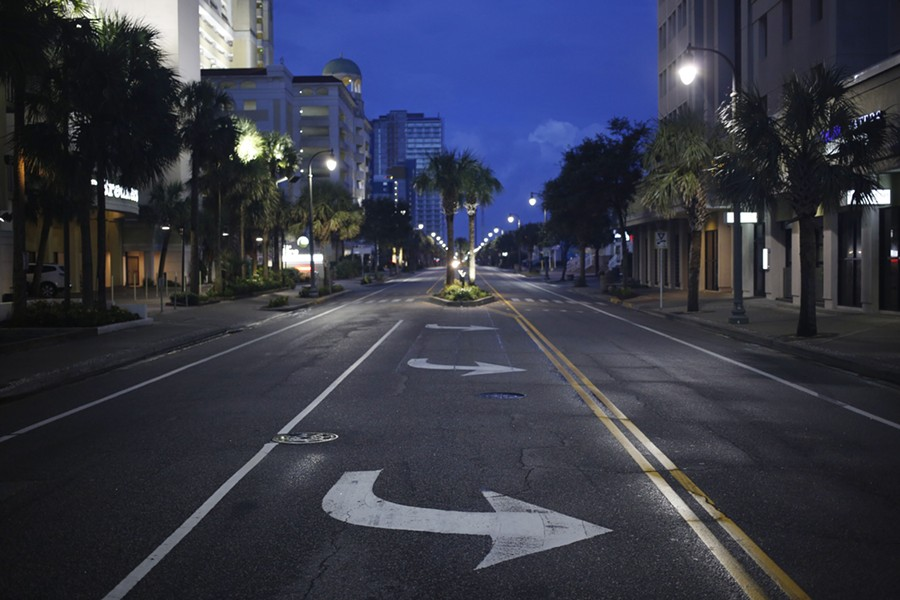 A quiet street at dawn in Myrtle Beach, S.C., Sept. 12, 2018. With millions of coastal residents either on the move or hunkering down anxiously in place, Hurricane Florence surged toward North Carolina on Wednesday, tracing an unusual path that could lead to tremendous destruction — especially if the immense storm dumps enormous amounts of rain as it moves inland. - LUKE SHARRETT/THE NEW YORK TIMES