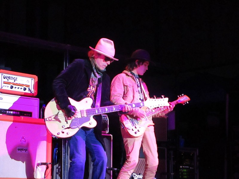 Bass player Tom Petersson and Robin Zander Jr., who is playing rhythm guitar on the band's 2018 tour dates. - DAN NAILEN