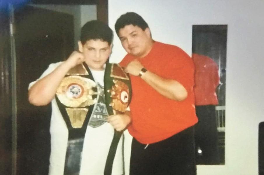 With his trainer, Joe Hipp.