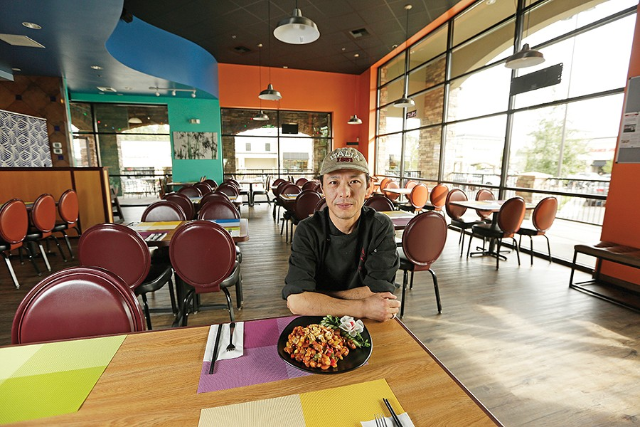 """Jianjun """"JJ"""" Lu, aka Chef Lu, serves family style, authentic Chinese cuisine at his South Hill Asian Bistro. - YOUNG KWAK"""