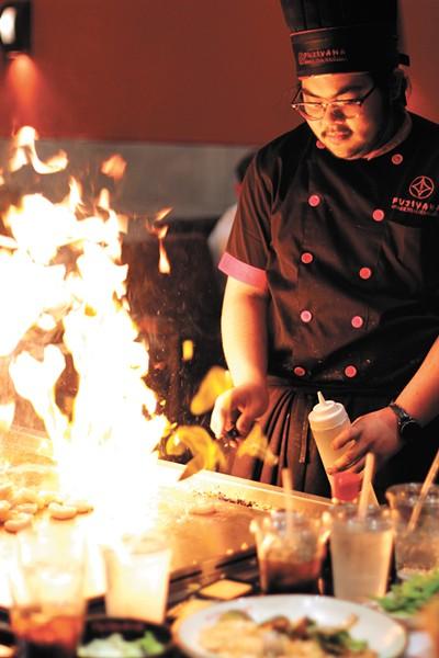 Fujiyama chefs play with fire. - CARRIE SCOZZARO PHOTO