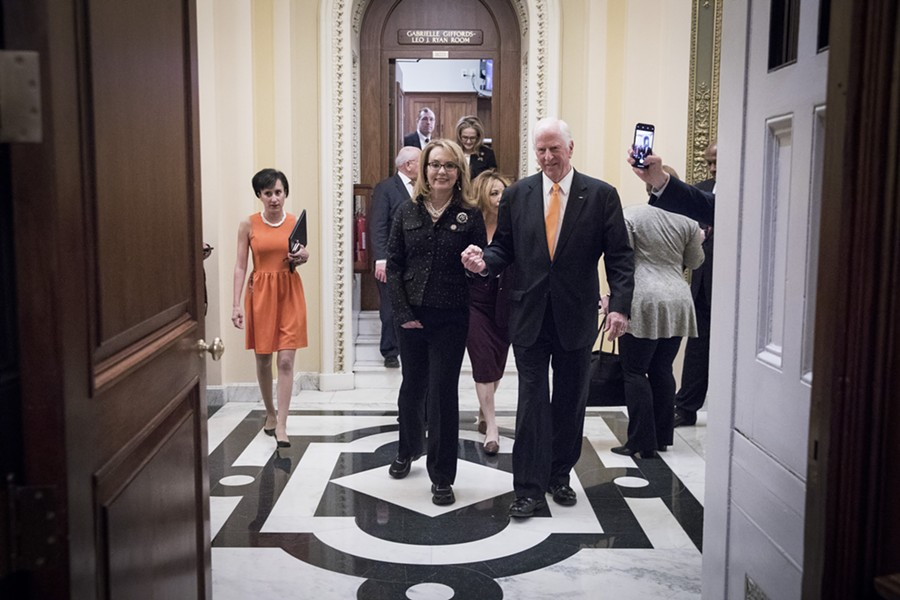 Former Rep. Gabby Giffords (D-Ariz.) and Rep. Mike Thompson (R-Calif.) leave the House Chambers in Washington, Jan. 8, 2019. Thompson is the chief sponsor of a  bipartisan bill that would expand background checks to nearly all firearms purchases, a move timed to mark the eighth anniversary of the mass shooting in Arizona that nearly killed Giffords. - SARAH SILBIGER/THE NEW YORK TIMES