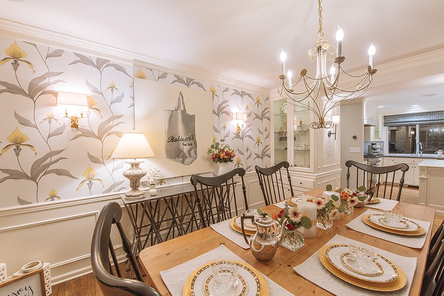 The large scale, contemporary botanical print wallcovering in designer Bridgit Wilson's dining room is from Cole & Son, a British company that's more than a hundred years old and specializes in hand-printed papers. - ERICK DOXEY PHOTO