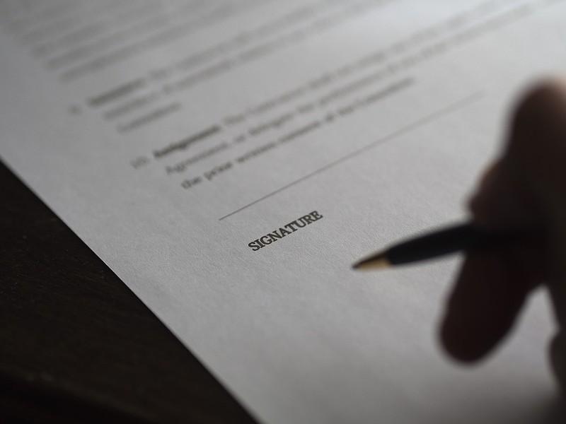 paperwork-signature-contract-deal-hand-business-962388.jpg