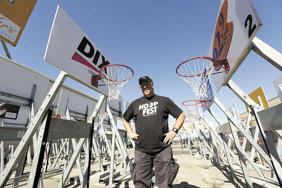 Hoopfest site manager Rob Davis spends months prior to the event prepping the hoops. - YOUNG KWAK