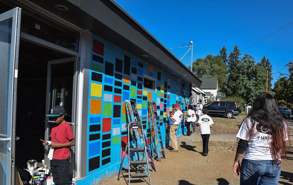 Gonzaga students came out last weekend to help paint the forthcoming restaurant's building. - MAKAYLA WAMBOLDT