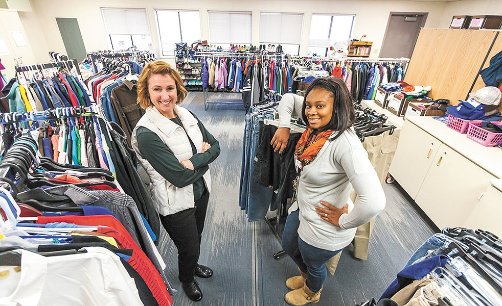 North Central Assistant Principal Wendy Bromley (left) and Community in Schools Support Coordinator Shamerica Daniels help homeless students with clothing. - JEFF FERGUSON