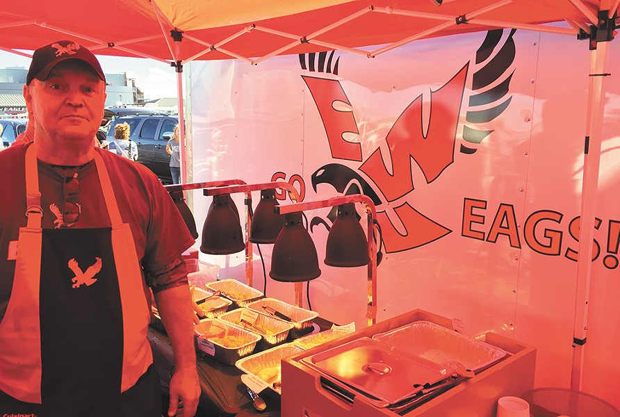 Tim Daniels cooks up a seafood buffet before some Eagles home games. - MAX CARTER