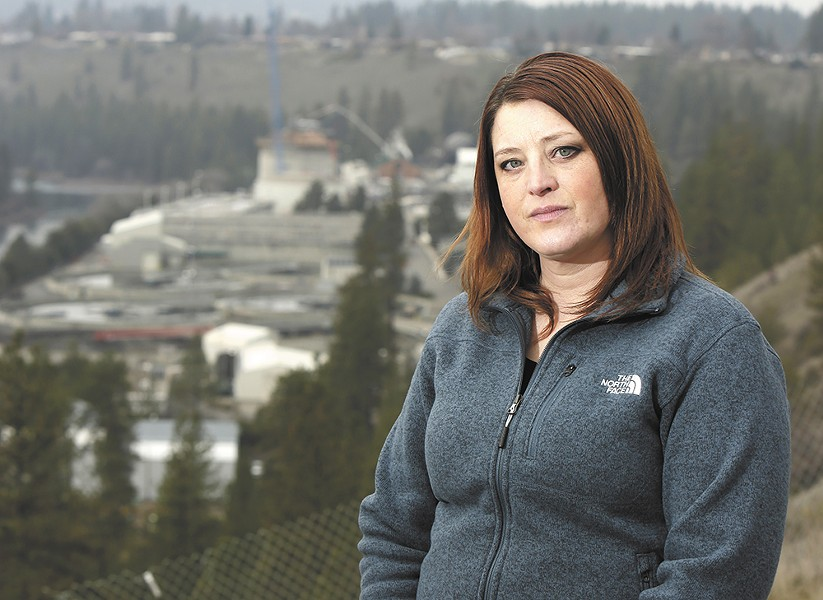 Sonya O'Brien stands on a bluff overlooking Riverside Park Water Reclamation Facility. She worked as an operator there for five years before being forced out due to what she says was a hostile work environment. - YOUNG KWAK