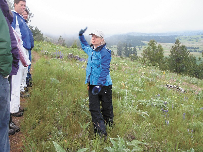 Jacie Jensen leads a tour of native plant species of the Palouse. - TRISH HEEKIN PHOTO