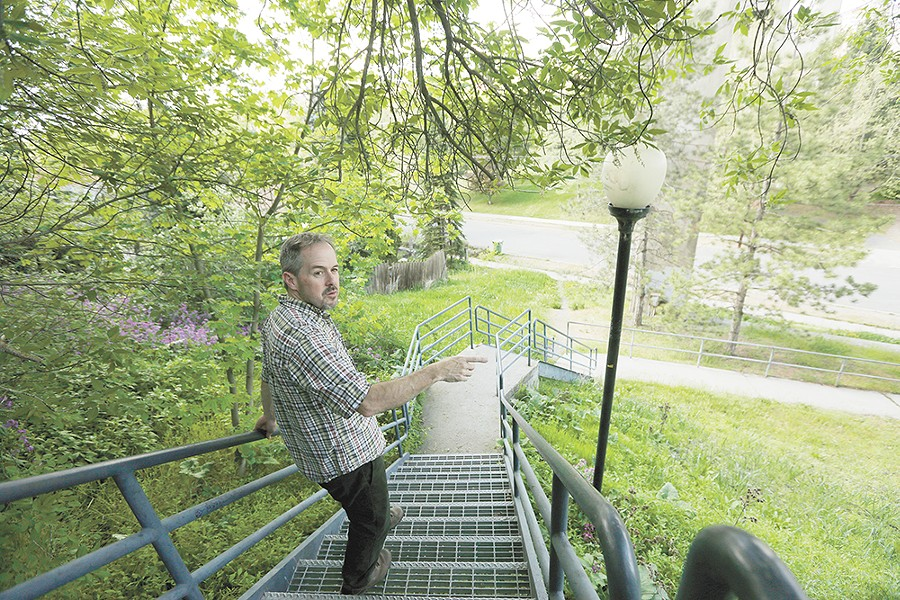 Tod Marshall strolls his Peaceful Valley neighborhood during a rare respite in his schedule as Washington's poet laureate. - YOUNG KWAK