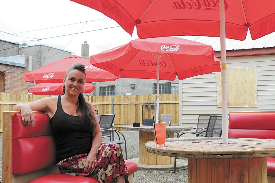 Owner Lora Corners at the Station House's expansive patio area. - FRANNY WRIGHT