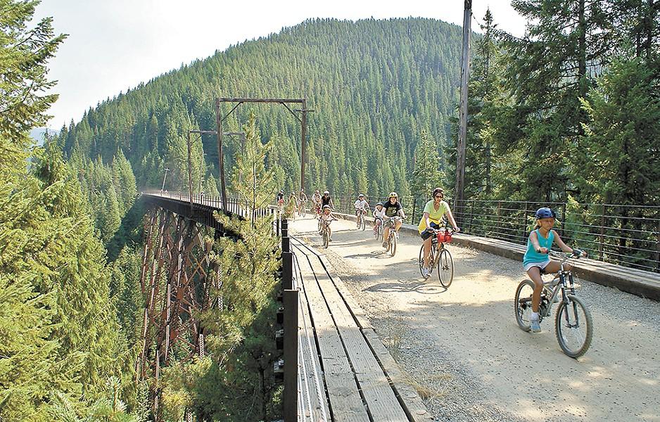 The Hiawatha Bike Trail runs along a former train track and connects Idaho and Montana.