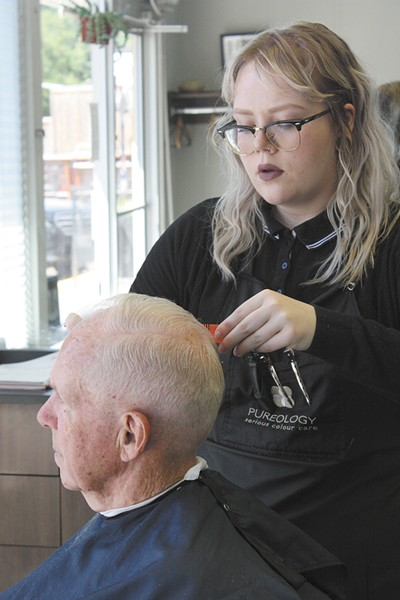 Barber Kendra McKay cuts Peter Joss's hair. - LAURA JOHNSON