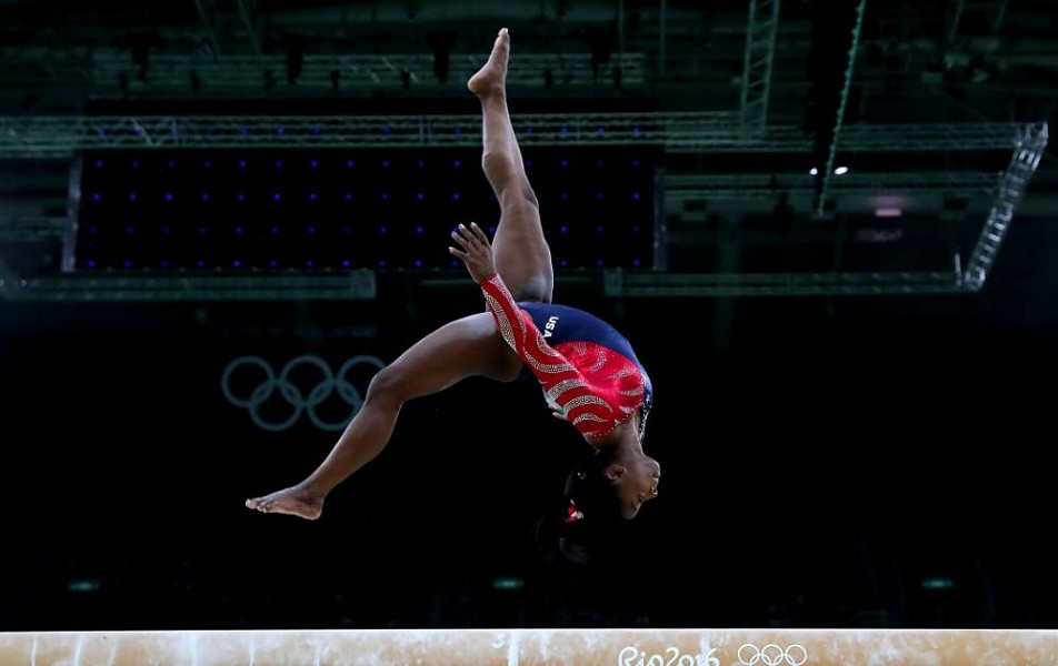 Simone Biles flawlessly flipped her way to team gold in Rio. - NBCOLYMPICS.COM