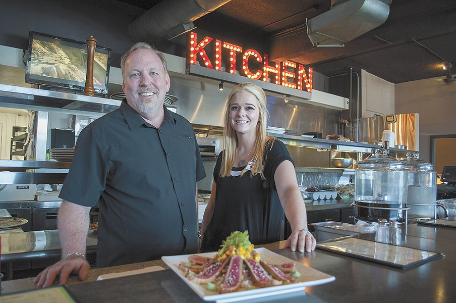 Rock City Grill owner Jim Rhoades and manager Chelsea Moore. - SARAH PHILP