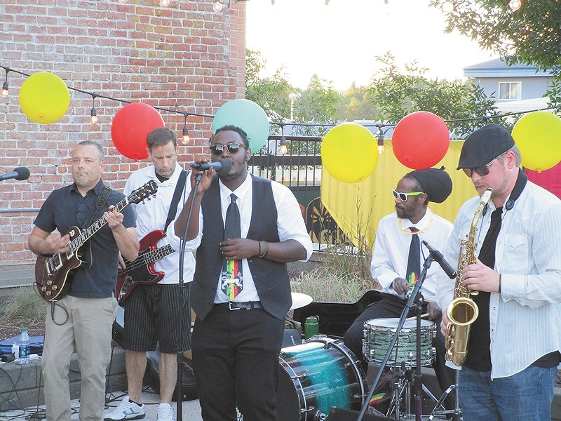 Omy's ban playing at a recent fundraiser on the Saranac rooftop. - DAN NAILEN