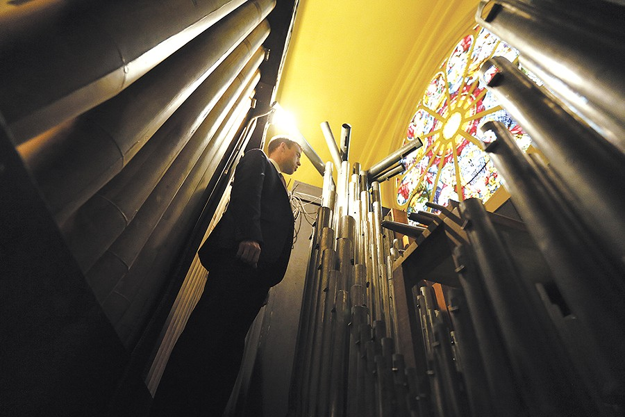 Music director Robert Carr inside the cathedral organ. - YOUNG KWAK