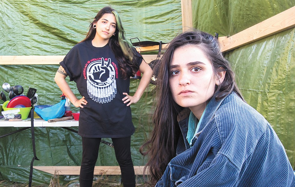 Lena Frame of the Seminole tribe and Tai Trewhella of New York, both 20, maintain a kitchen at the camp. - JEFF FERGUSON