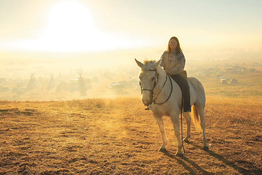 Tracy Hsu from Elgin, North Dakota, and her horse Ashley. - JEFF FERGUSON