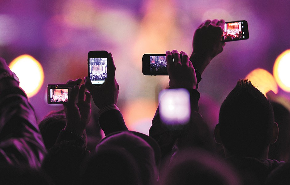 People are viewing concerts through their hand-held screens more and more.