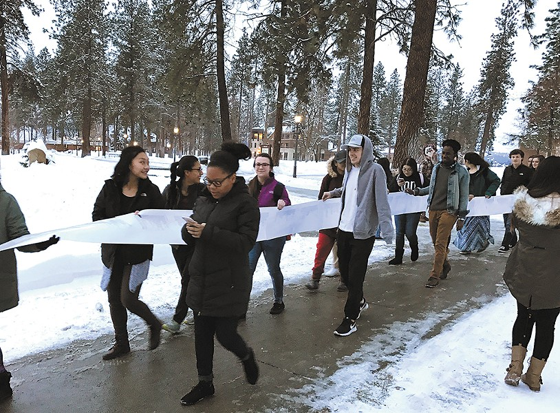 "Whitworth students march to the university president's office with a petition to declare the school a ""sanctuary campus."""