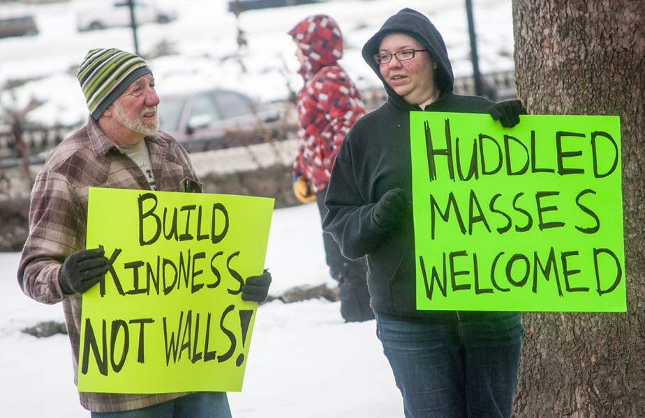 """Build kindness, not walls!"" ""Huddled masses welcomed"" - DANIEL WALTERS PHOTO"