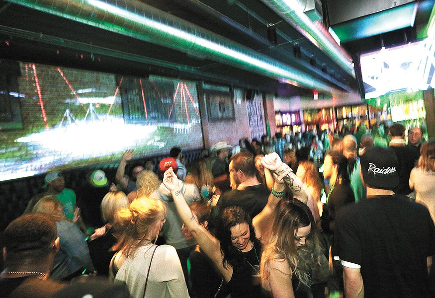 The Globe Bar & Kitchen transforms into a dance club on Friday and Saturday nights. - YOUNG KWAK