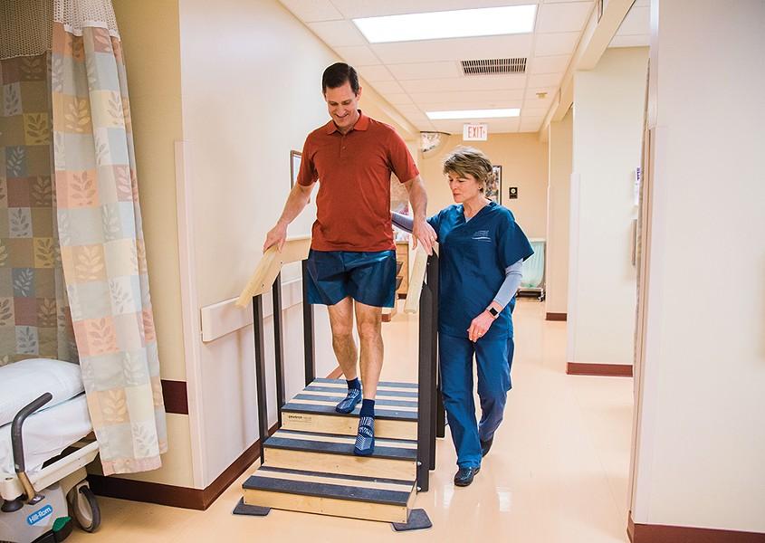 Outpatient surgery coordinator Sandy Phillip assesses Kimball's stair climbing. - JENNIFER DEBARROS