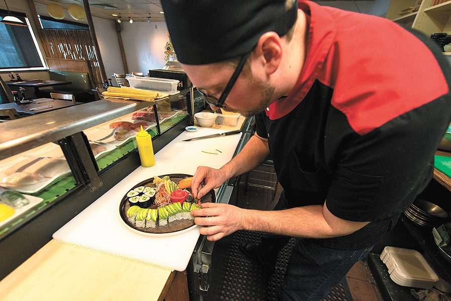 Aji sushi chef Matt Penley stayed on through the transition from Yuzen to Aji BBQ & Sushi. - ERICK DOXEY