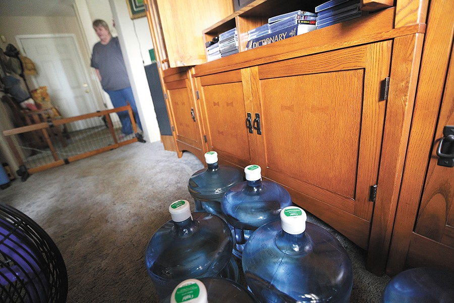 Residents are getting jugs of water, like these in Barb Collins' home. - YOUNG KWAK