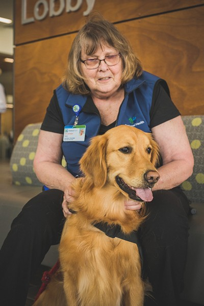 Carol Cook and her golden retriever, Molly, volunteer at Kootenai Health. - DAN COUILLARD