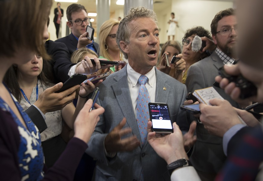 Sen. Rand Paul (R-Ky.), who opposes current Senate health care bill, comments on its Congressional Budget Office score, in Washington, June 26, 2017. The bill would increase the number of people without health insurance by 22 million by 2026, only slightly lower than the 23 million more uninsured that the House version would create, according to the CBO. - STEPHEN CROWLEY/THE NEW YORK TIMES