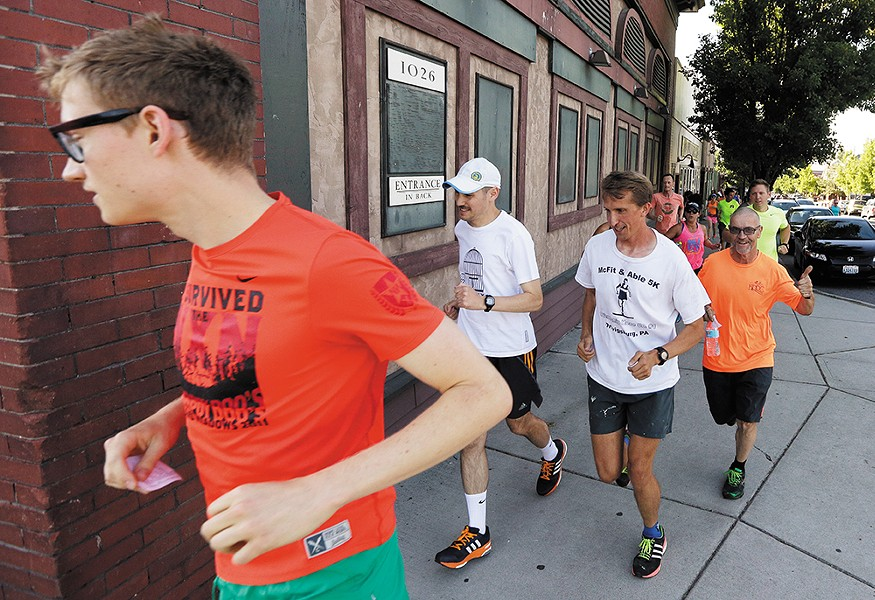 Runners take to the streets in the South Perry District as part of the Lantern Running Club. - YOUNG KWAK