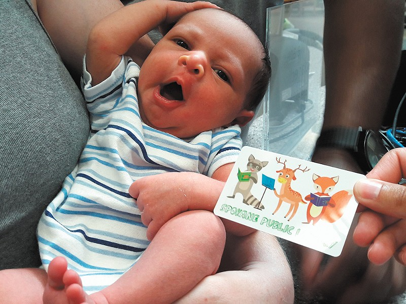 Baby Grant is one of the program's newest library card holders. - RAE-LYNN BARDEN