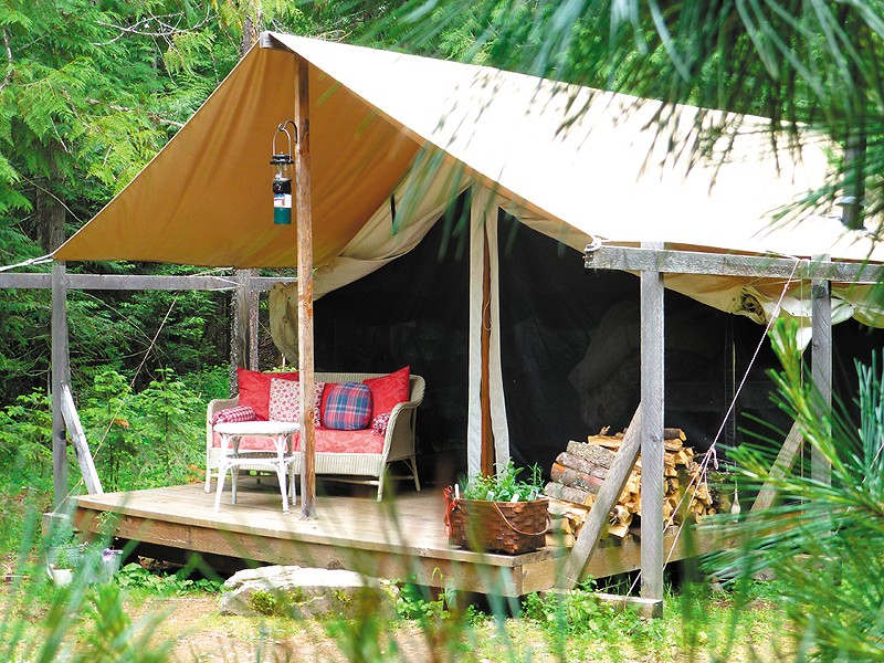 Huckleberry Tent's canvas-walled tents feature porches and a wood-burning stove.
