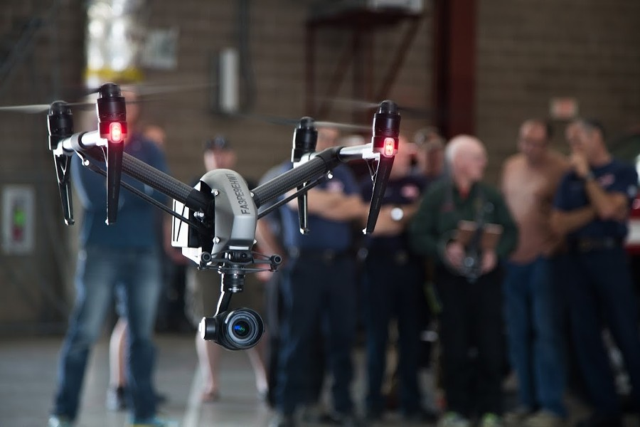 Members of the Spokane Fire Department's drone team watch a demonstration. - COURTESY OF SFD