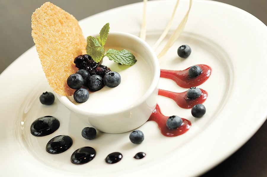 Huckleberry compote adds a tart bite to Wild Sage's Wild Berry Panna Cotta. - YOUNG KWAK