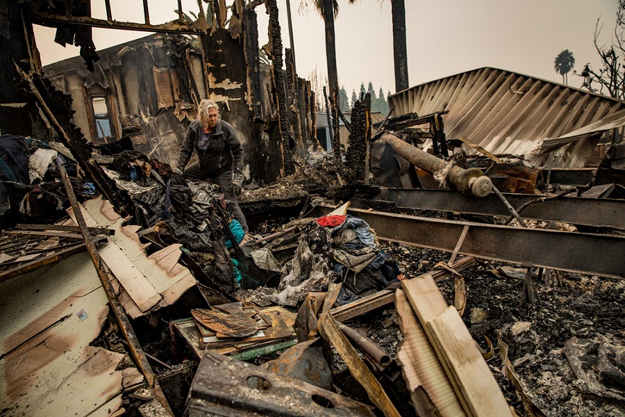 Nancy Cook sifts through the remains of her home at the Journey's End Mobile Home Park after a wildfire passed through in Santa Rosa, Calif., Oct. 10, 2017. - JOSH HANER/THE NEW YORK TIMES