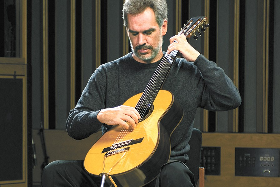 Paul Galbraith plays his eight-stringed Brahms guitar, inspired by a Renaissance-era instrument. - PETER MACKAY