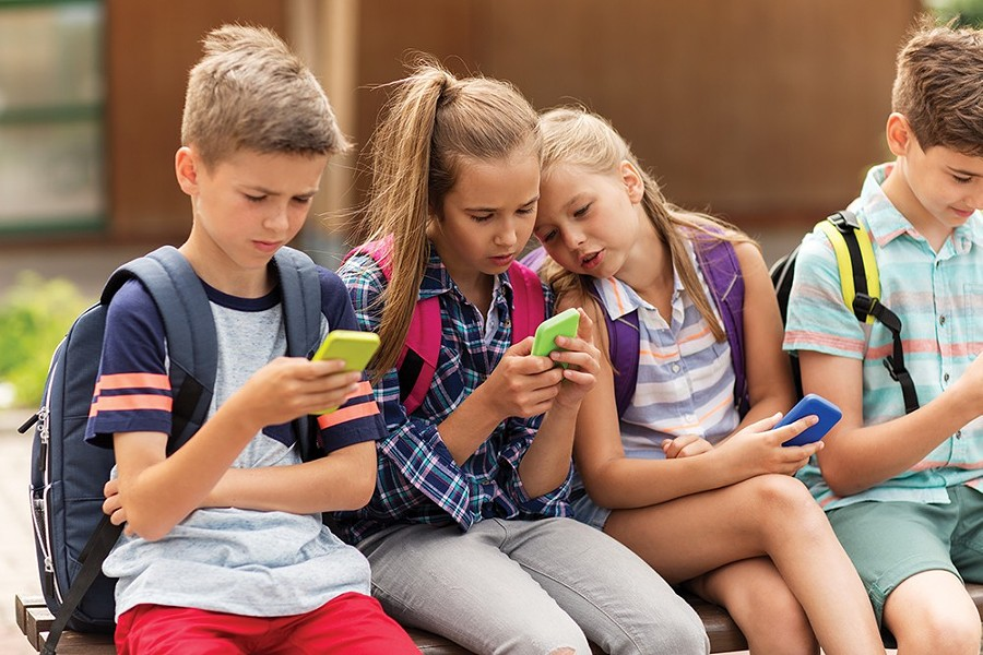 Just how much phone time is OK for kids? At least put the phones down during dinner.