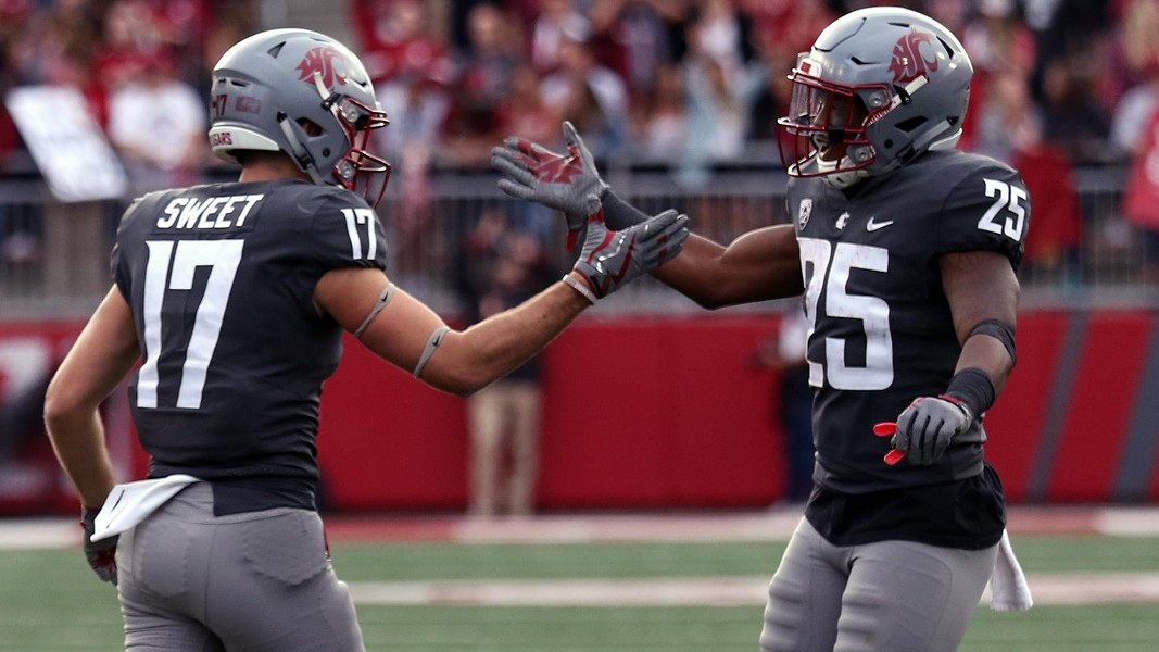 Senior captain Jamal Morrow, right, who has averaged 7.1 yards per carry, caught 39 passes out of the backfield and leads the Cougars with eight touchdowns, will play for the final time at Martin Stadium on Saturday. - WSU ATHLETICS