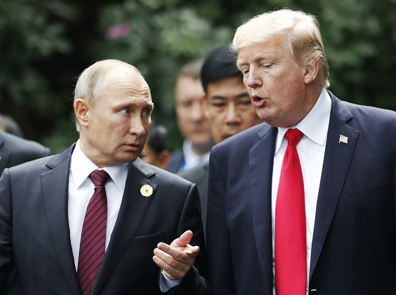 "President Donald Trump and President Vladimir Putin of Russia converse as leaders participating in the APEC summit took a group photo, in Danang, Vietnam, Nov. 11, 2017. Trump said on Saturday that he believed Putin's denials of interference in the 2016 presidential elections were sincere. ""Every time he sees me he says, 'I didn't do that,' and I really believe that when he tells me that, he means it,"" Trump said. - JORGE SILVA/POOL VIA THE NEW YORK TIMES"