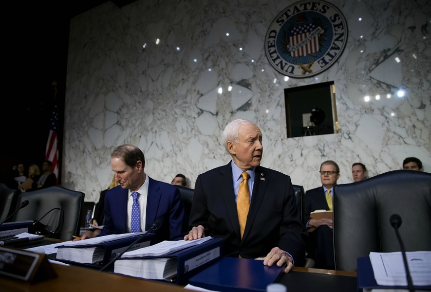 Sen. Orrin Hatch (R-Utah) chairs a Senate Finance Committee executive session on tax policy, on Capitol Hill in Washington, Nov. 15, 2017. Senate Republicans have decided to include the repeal of the Affordable Care Act's requirement that most people have health insurance into the sprawling tax rewrite. At left is Sen. Ron Wyden (D-Ore.), the ranking Democrat on the committee. - ERIC THAYER/THE NEW YORK TIMES